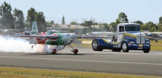 The Bandag Bullet truck racing with a plane